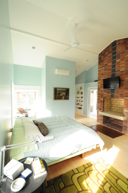A combination of light colors from the floor to the ceiling brightens up this master bedroom. Photo by GriD architects