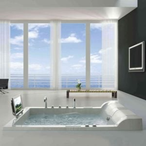 Blue sky and white clouds seem to be the finishing touch for this luxurious bathroom.