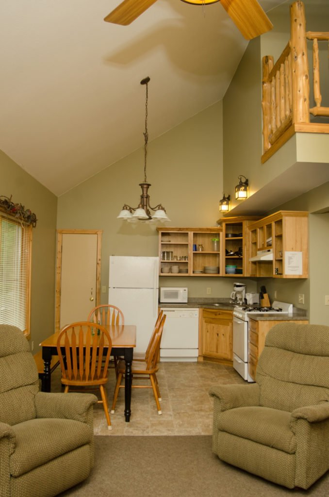 The compact L-shaped kitchen is made to look more spacious with vaulted ceiling.