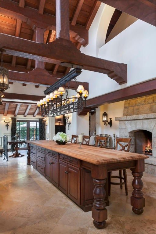 Large traditional kitchen is made to look more spacious than it already is with the vaulted ceiling.