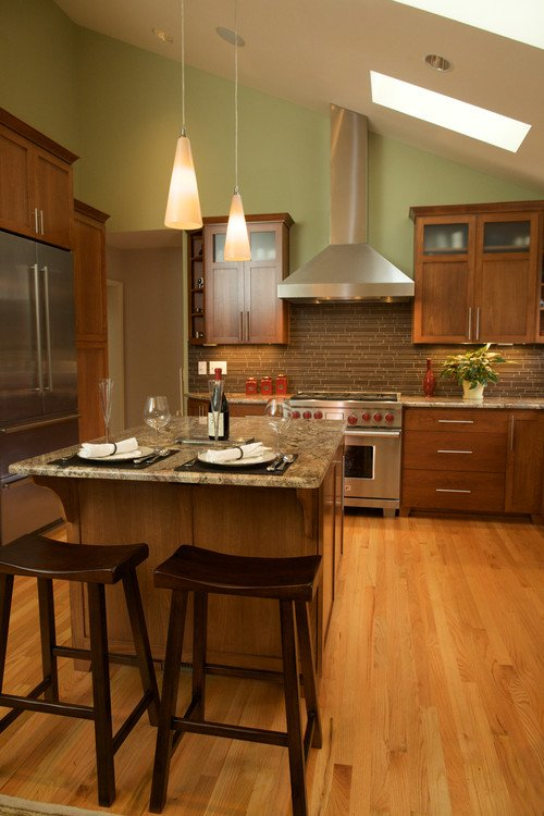 This transitional kitchen in Portland has a vaulted ceiling with skylights to make this kitchen look spacious.