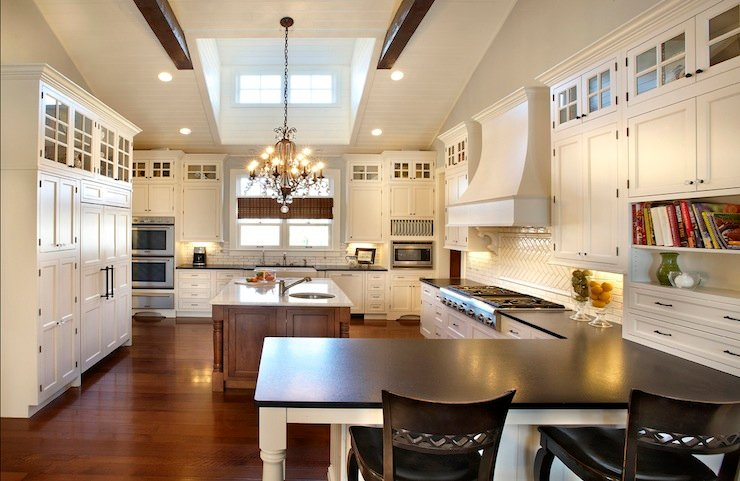 Vaulted ceiling and skylight both provide an airy atmosphere to this sophisticated kitchen.