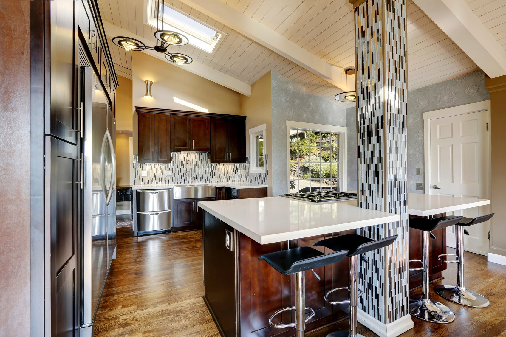 The tile- decorated pillar catches anyone's attention in this kitchen.
