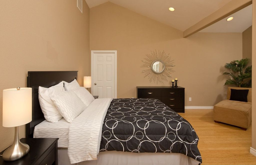 Light wooden flooring blends with the soft pastel of the walls to create a cozy and relaxing environment.