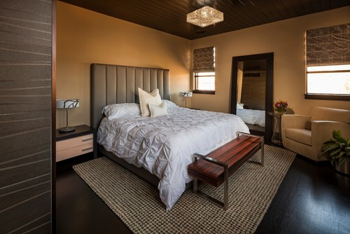 This master bedroom offsets the bareness of the beige walls with textured accents.