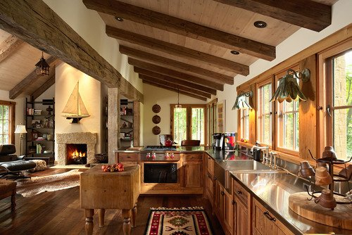 This rustic kitchen in Minneapolis enlarges the space with the vaulted ceiling.