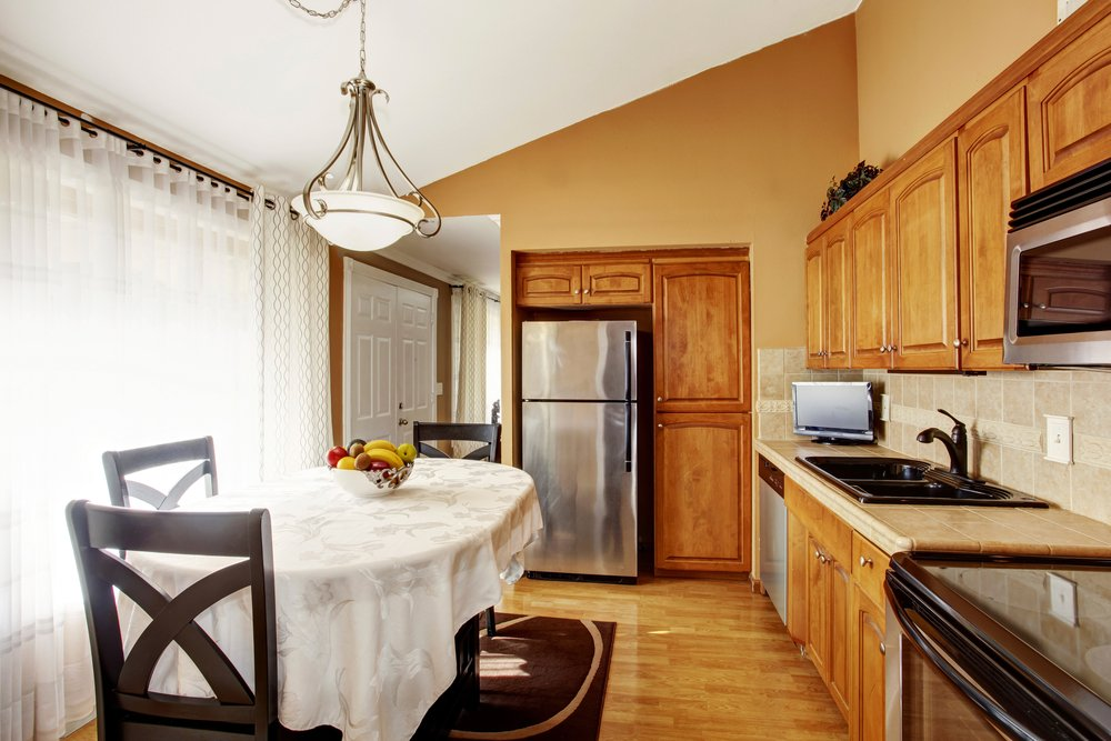This small one-wall kitchen looked bigger because of the vaulted ceiling.
