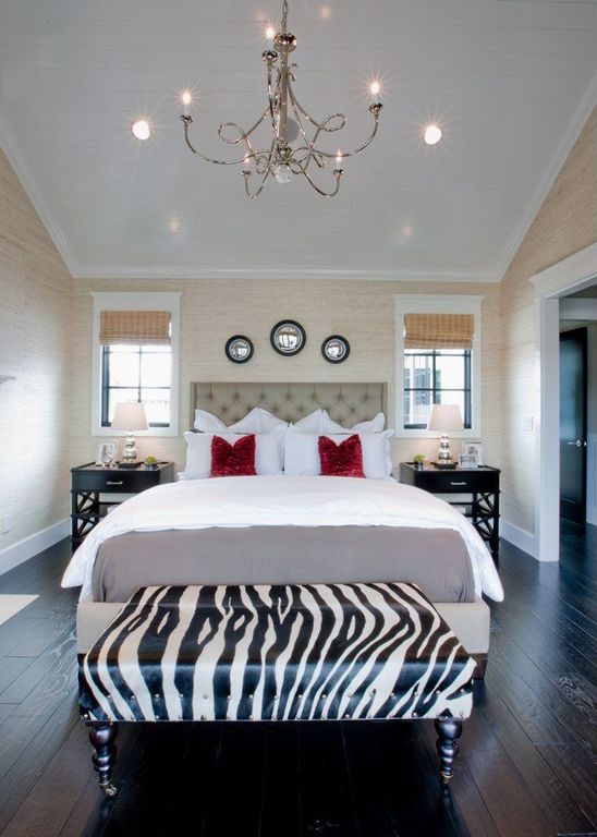 The rich tones of ebony wood floors set a dramatic backdrop for this master bedroom.