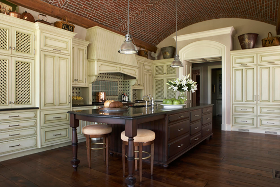 The barrel- vaulted ceiling in this kitchen is a work of art.
