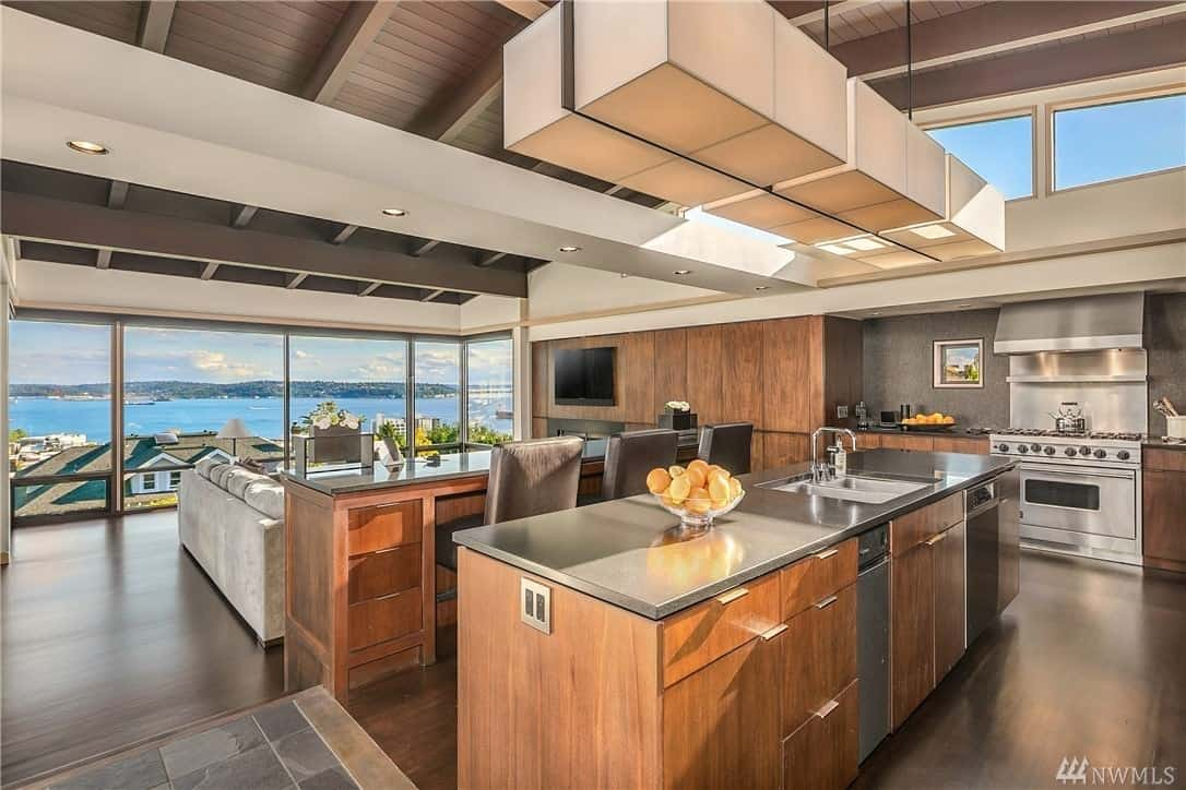 Incredible modern kitchen with 2 islands and a stunning view and cathedral ceiling.