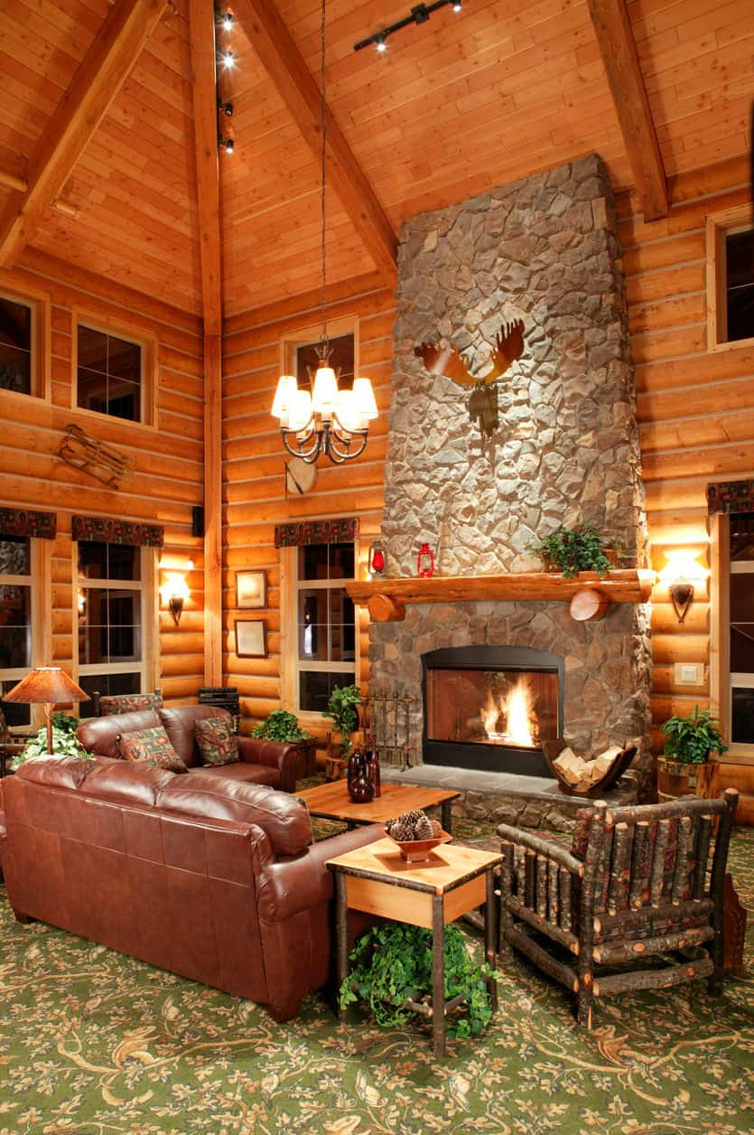 ... Log Home Interior Designs. Fabulous Living Room With 3 Story Towering  Ceilings And Huge Rock Fireplace Rising Up 30