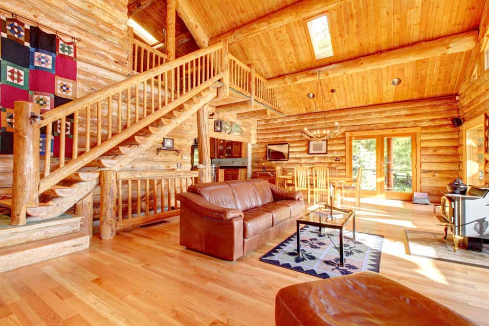 Another Photo Of Log Home Great Room With Towering Cathedral Ceiling.