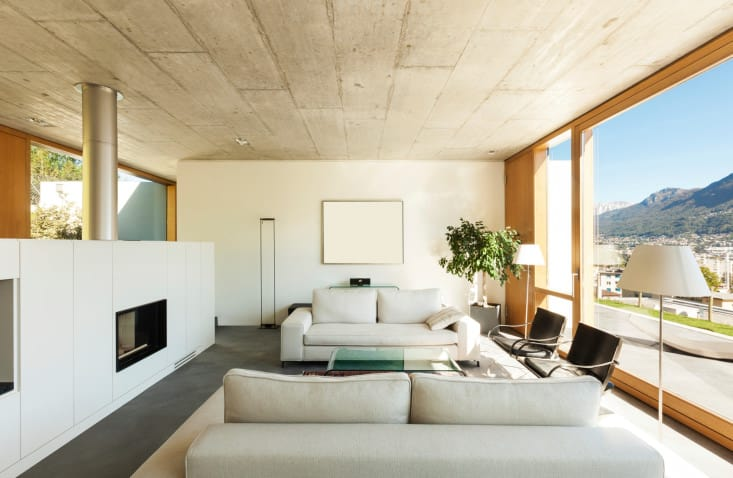 Similar to the previous room, this one also uses materials and effects used for flooring as part of the ceiling for a warped, but incredibly stylish and modern effect. The blank painting on the wall only adds to the mystery of the design.