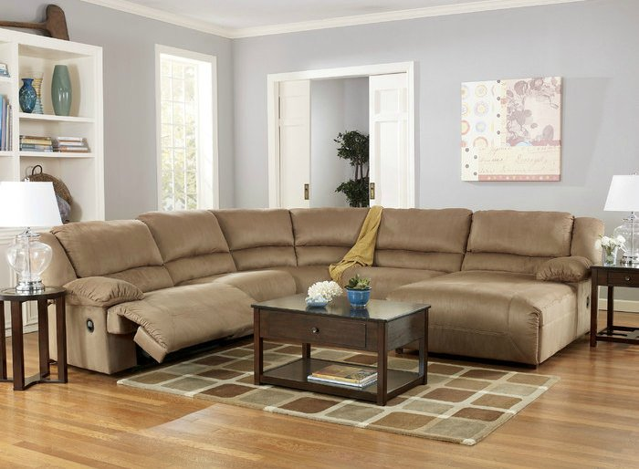 Comfortable beige microfiber reclining sectional sofa.