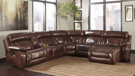 Ultra comfortable brown leather sectional with multiple reclining seats.