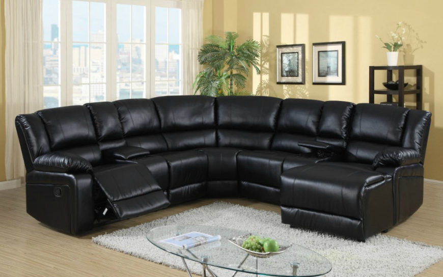 Smaller black leather reclining sofa.
