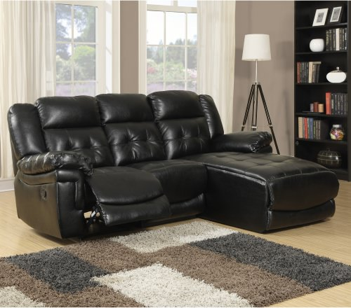 Small black leather reclining sofa.