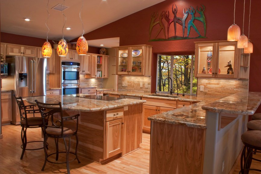 Large kitchen with red walls and white shed ceiling. The hardwood flooring matches the kitchen counters and cabinetry.
