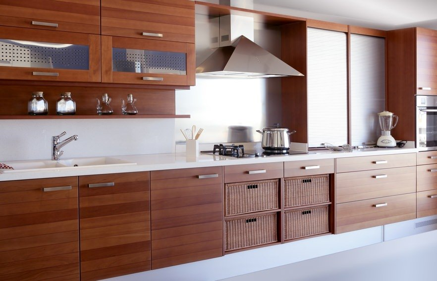 This kitchen features lovely cabinetry matching the kitchen counters with white countertop.