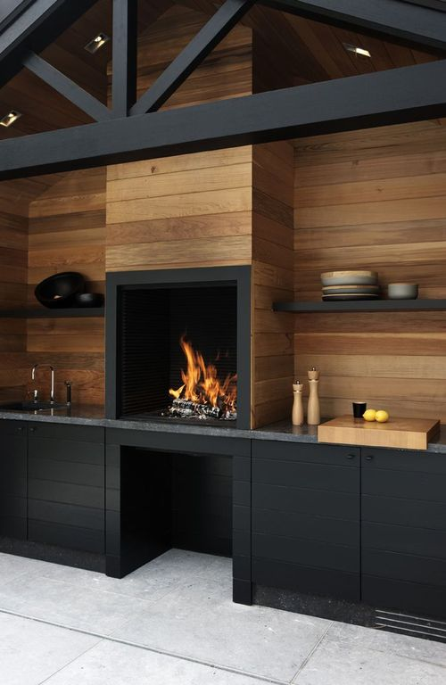 Contemporary outdoor kitchen featuring a very stylish matte black finished bar counters and shelves.