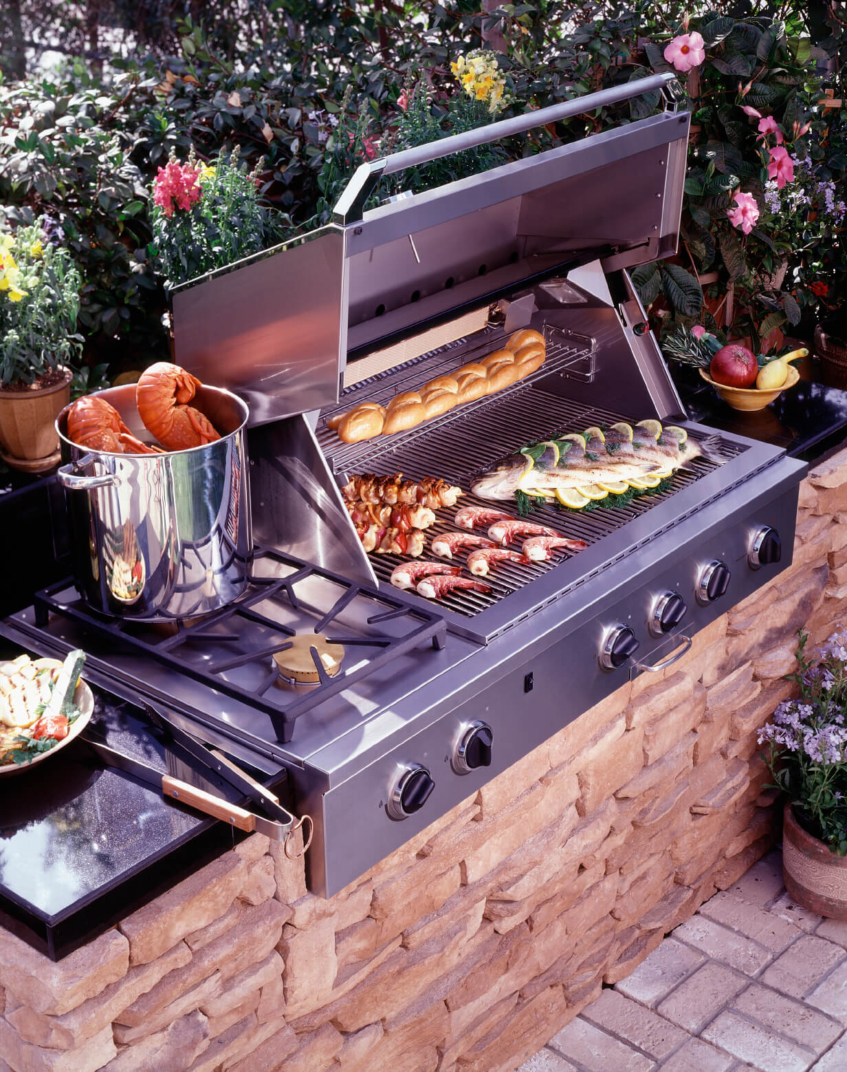 A close up look at the outdoor kitchen's stove and grill.