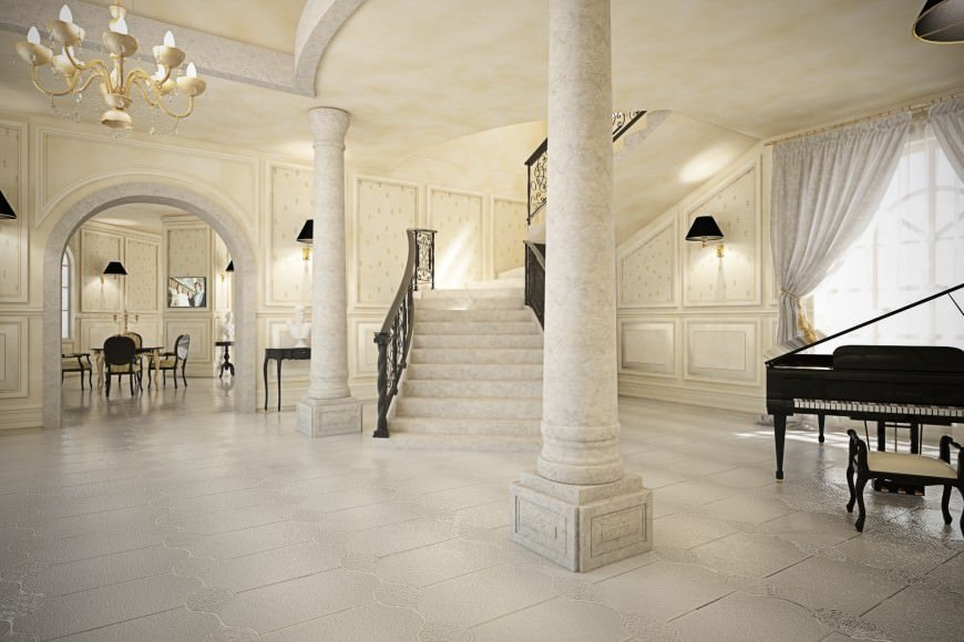 This large foyer features classy walls, pillars, flooring and ceiling, along with the staircase and chandelier.