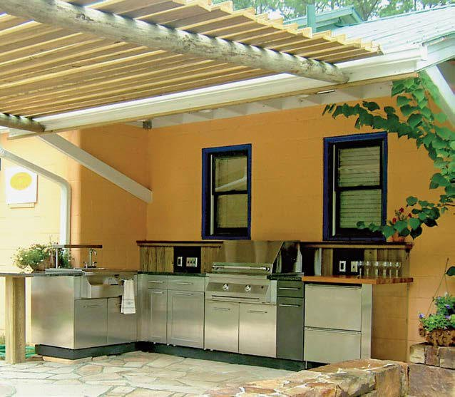 This outdoor kitchen features a nice set of stainless steel appliances.