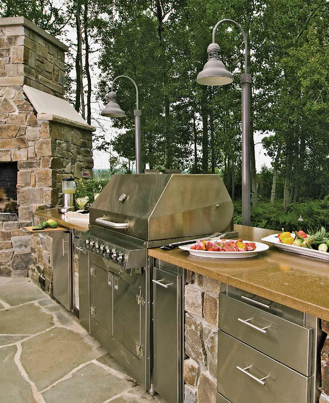This outdoor kitchen boasts top-of-the-line appliances combined with the large bar setup.