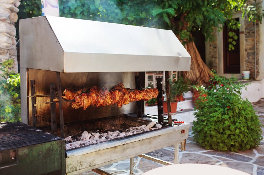 A close up look at this outdoor kitchen's rotisserie area.