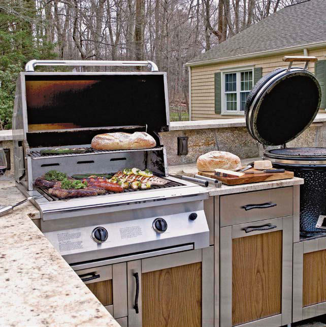 This outdoor kitchen offers a large bar with a marble countertop and top-of-the-line appliances.