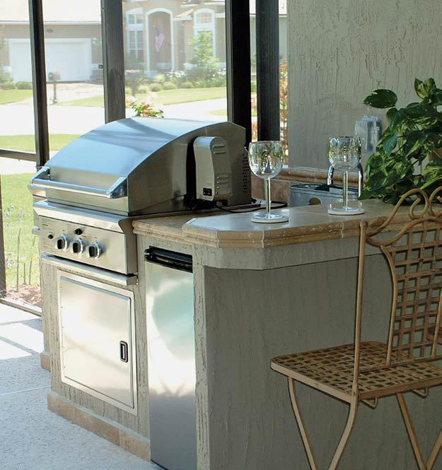 A close up look at this outdoor kitchen's small bar with a breakfast bar space.