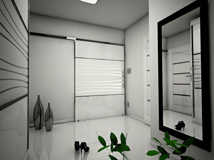 Black and white modern entry with smooth white tiles flooring and walls. Plants on the side add additional color.
