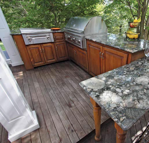 This outdoor kitchen set on the home's deck boasts a medium counter with very stylish countertop.