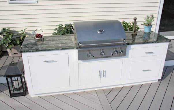 Focused shot at this outdoor kitchen's medium bar with stylish countertop.