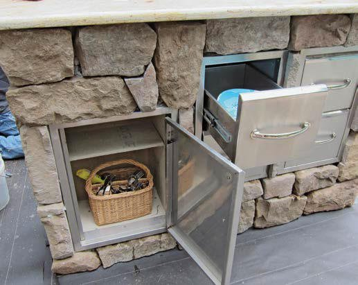 Focused shot at this outdoor kitchen's built-in storage inside the stone-made counter.
