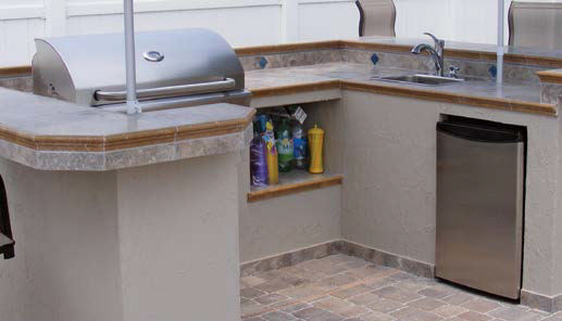 A close up look at this outdoor kitchen's bar and counter setup.
