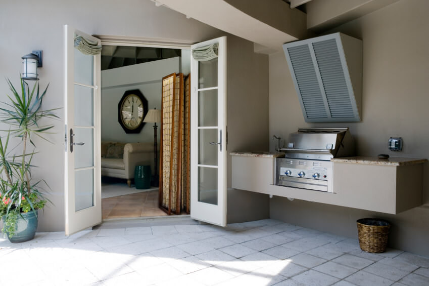 Outdoor kitchen features a floating vanity counter with marble countertop.