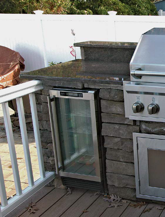 A focus shot at the outdoor kitchen's built-in fridge.