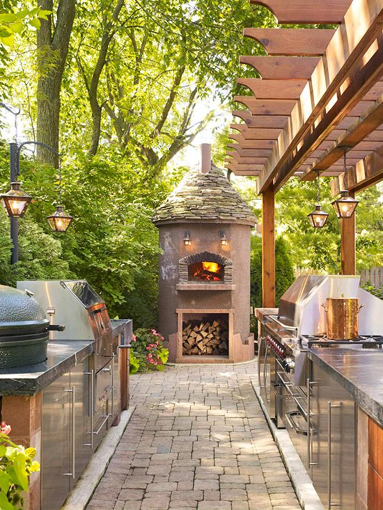 This outdoor kitchen features granite countertops on both bar counters. Top-of-the-line appliances are equipped in this outdoor kitchen.