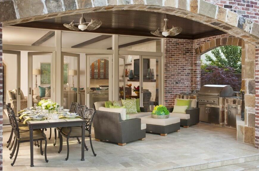 This patio area combines with the home's outdoor kitchen and dining. The rattan seats with white cushion and foam backrests look perfect together with the dining table set.