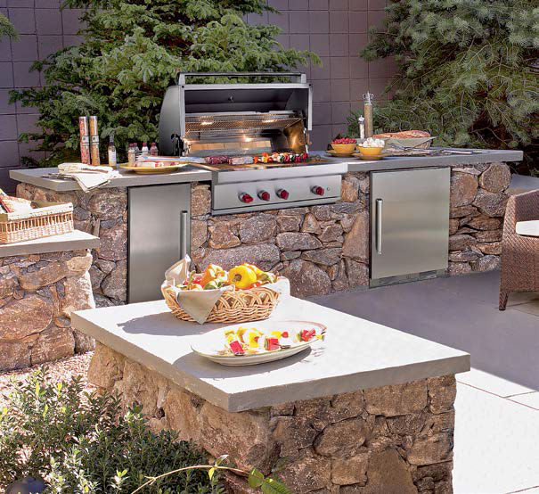 This large outdoor kitchen boasts multiple bars with smooth counters along with an outdoor living set on the side.