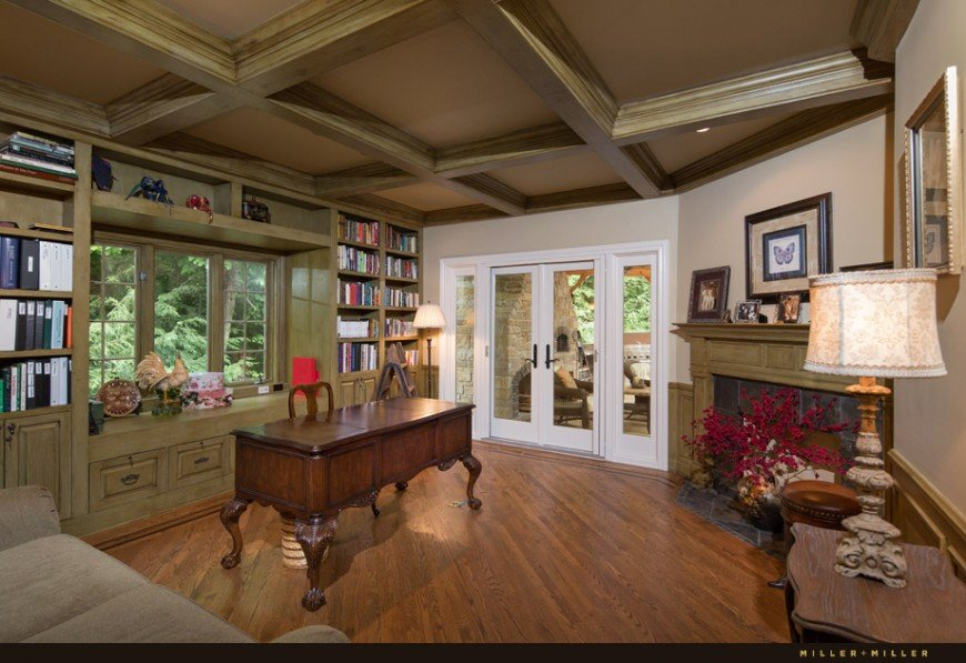 A medium-sized home office featuring a classy coffered ceiling that looks perfect together with the room's style.