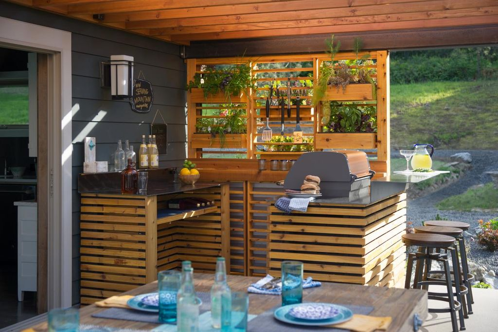 Stylish outdoor kitchen featuring a small bar counter area.