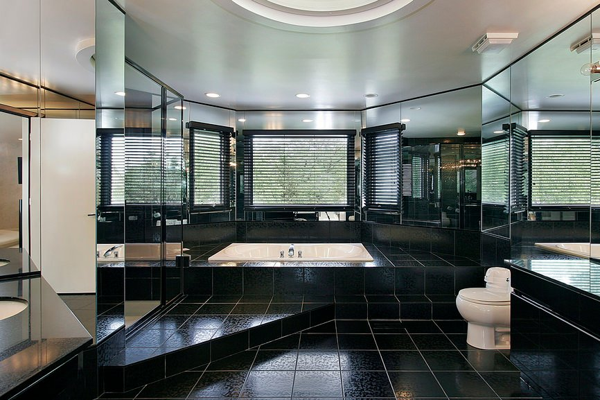 The black tiles flooring and walls of this master bathroom made it look so handsome. Added by the mirrors surrounding the area, the room became so stunning and elegant.