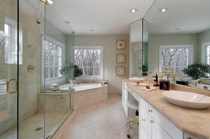 Master bathroom featuring a corner tub, a walk-in shower and a powder area with two vessel sinks on both sides.