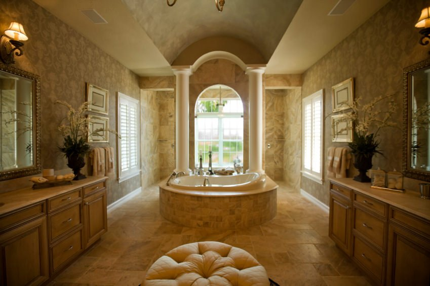 Large master bathroom boasting a stunning bathtub set up surrounded by elegant walls and classy tiles floors.