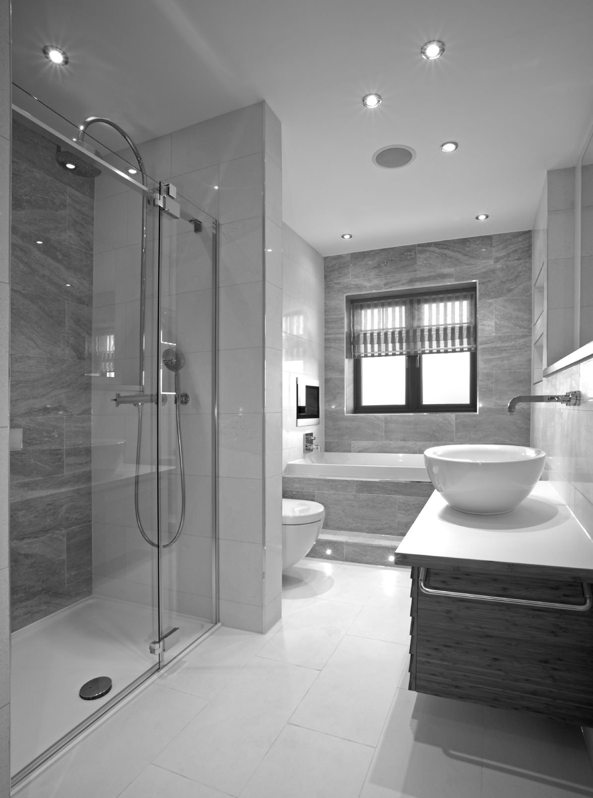 This bathroom has an impressive rain shower, a rounded basin, and a window side tub – what more could you want?