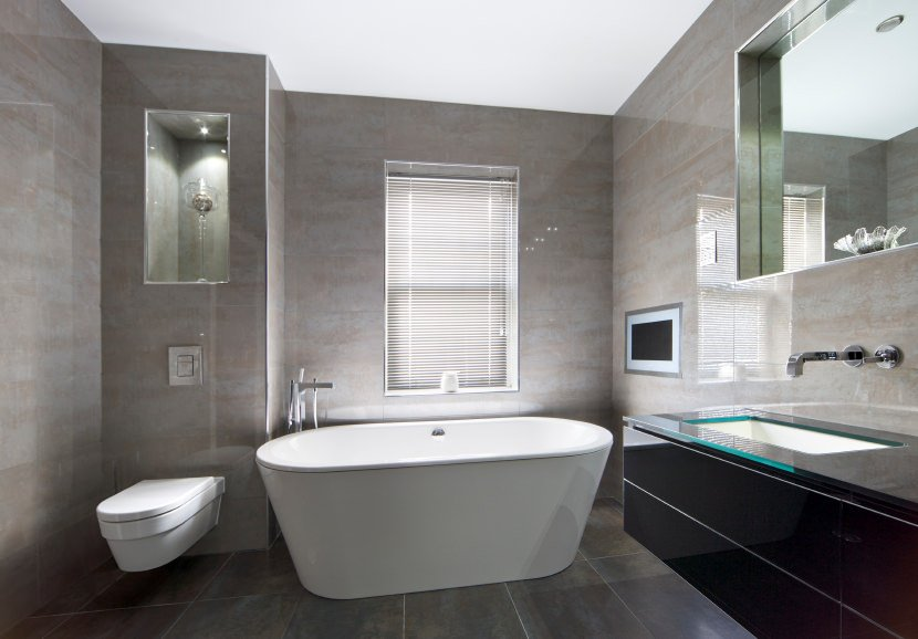 Primary bathroom featuring gray tiles walls and floors, along with a tall ceiling. The room has a freestanding tub and a stylish floating vanity sink.