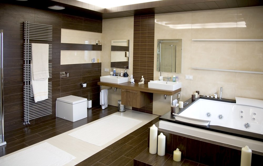 Large master bathroom with a classy soaking tub, along with a couple of vessel sinks. The walls and floors look very stylish.