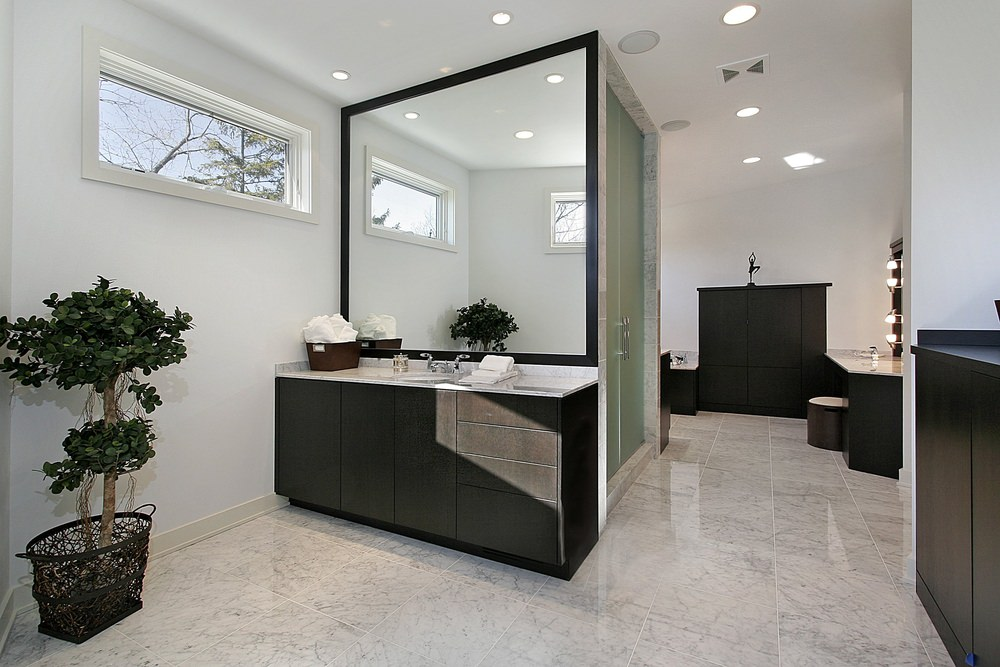 Primary bathroom with white walls along with a black shade. It features marble tiles flooring and an open shower room.